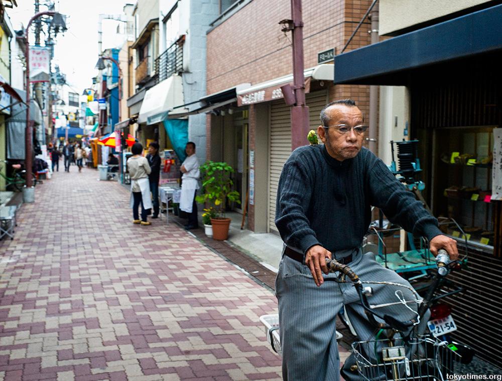 Japanese man and his budgerigar