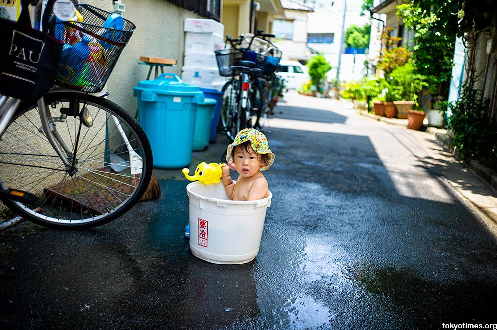 Japanese boy in a bucket in Tokyo