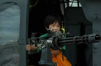 boy_with_gun.jpg