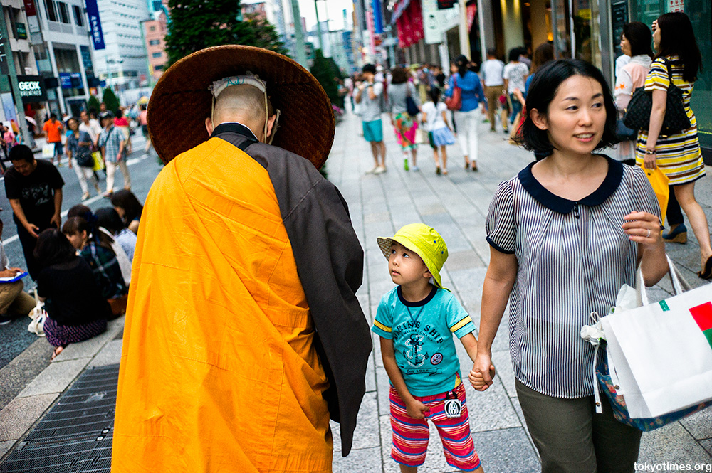 Japanese Buddhist monk and surprised boy in Tokyo
