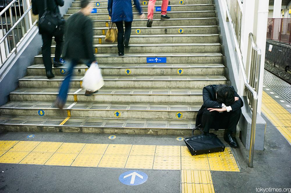 drunk and asleep Japanese salary man
