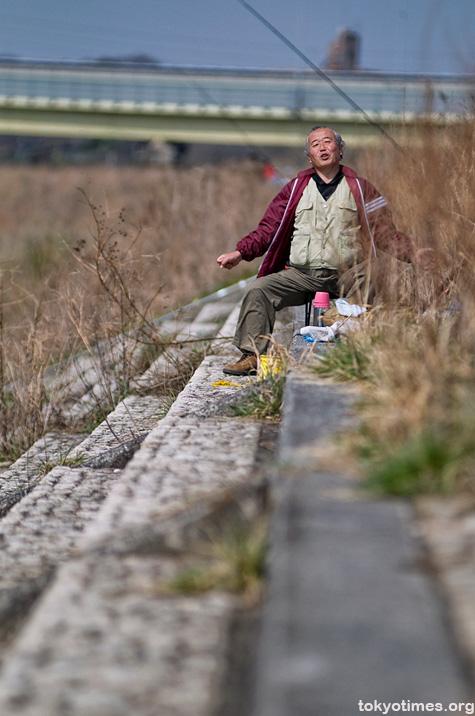 old Japanese man fishing