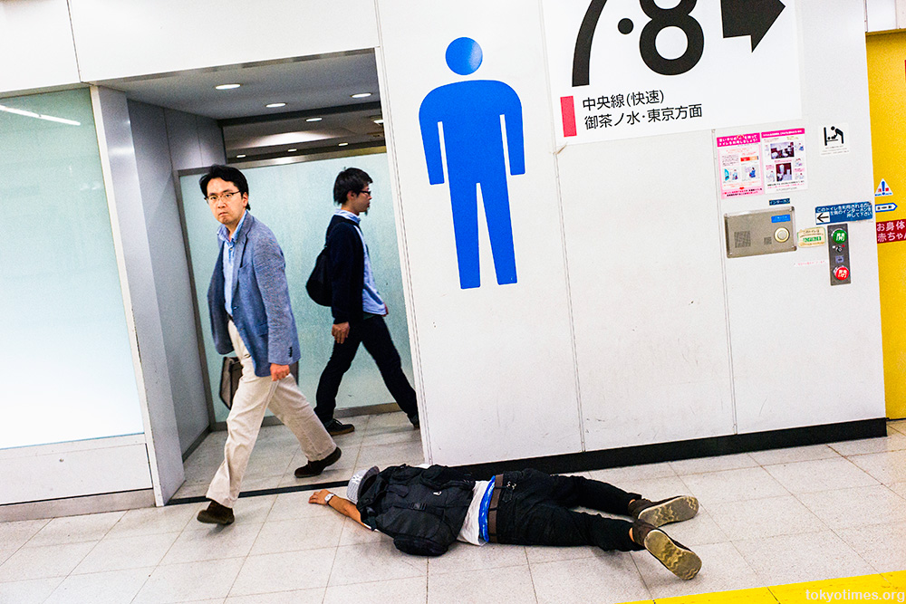 drunk Japanese man man passed out in Tokyo
