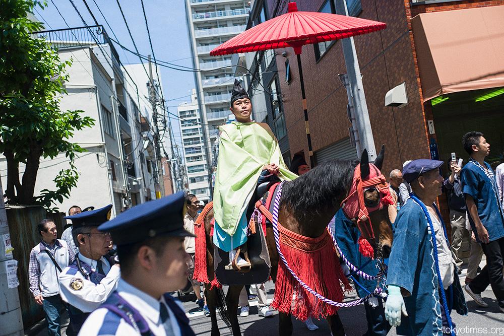 Japanese priest on horseback in Tokyo
