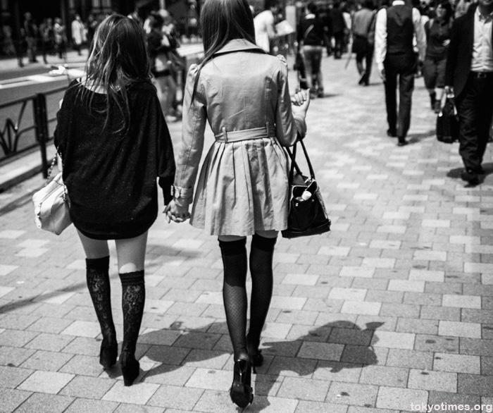 Japanese girlfriends holding hands