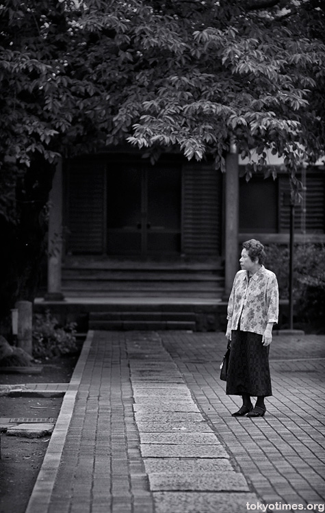An old Japanese lady at a Tokyo temple