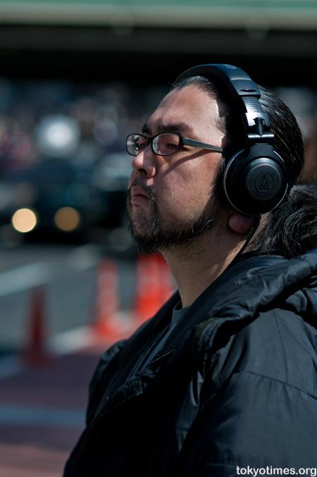 Japanese man wearing headphones