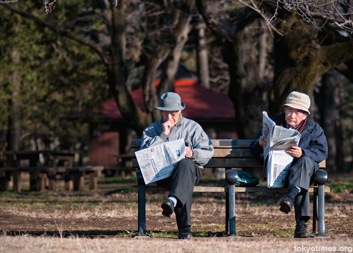 Japanese old men reading newspapers