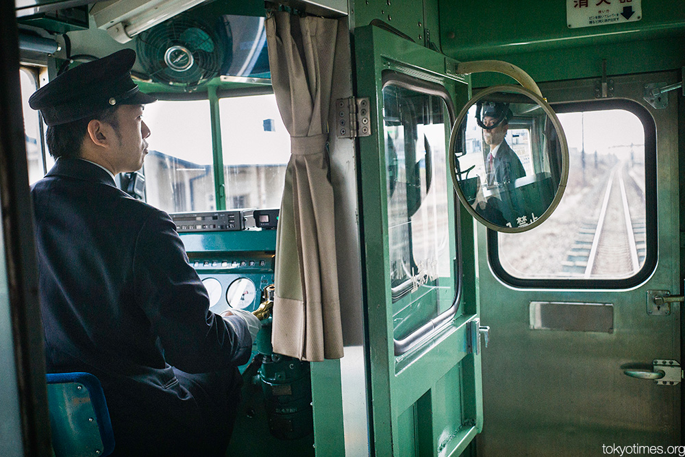 old Japanese train and its driver