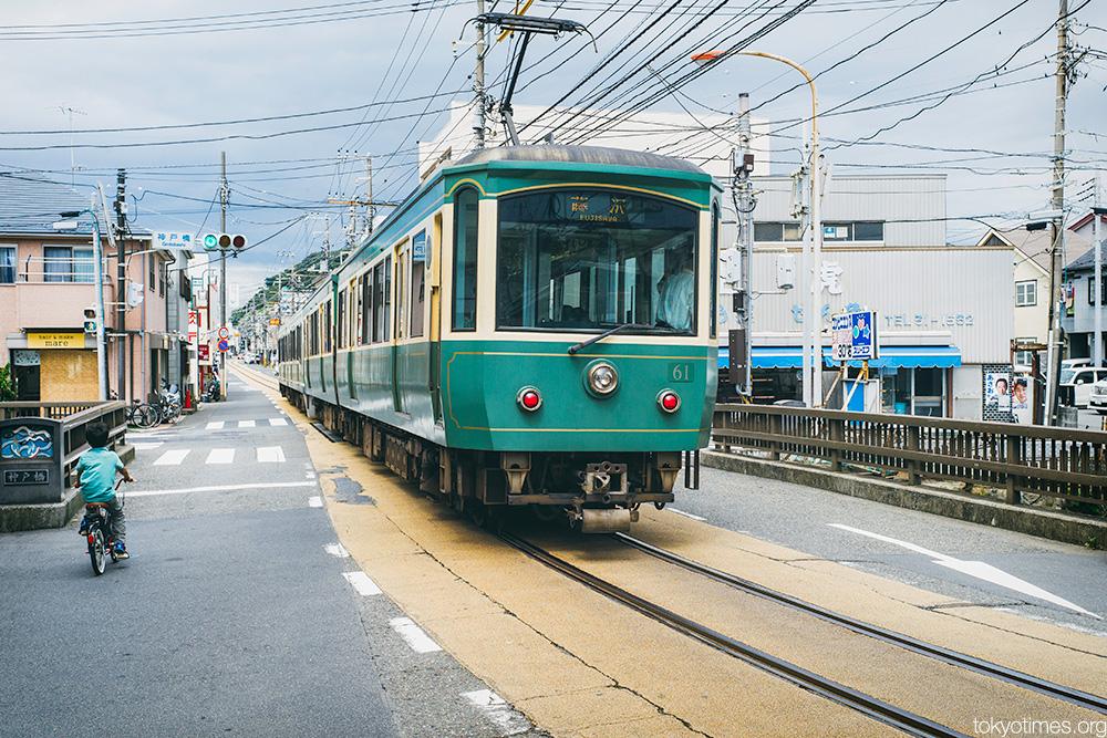 Old tram in modern Japan