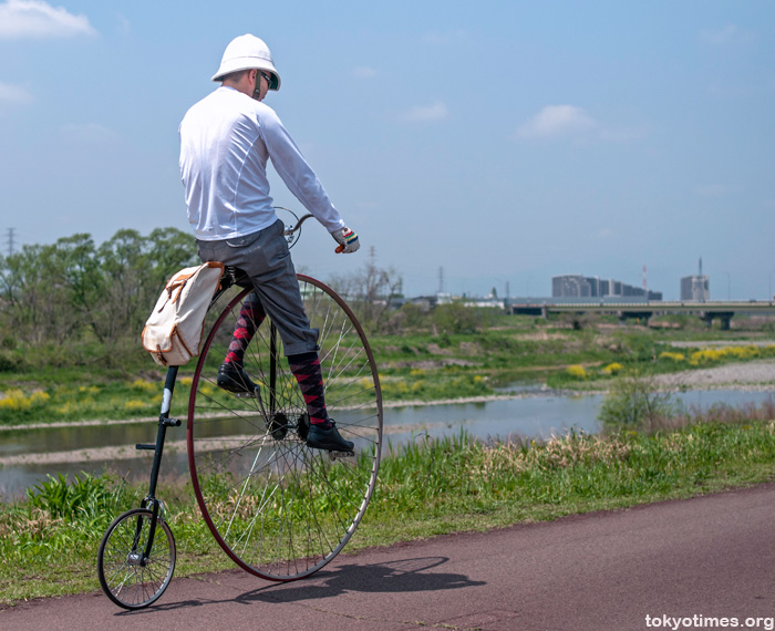 Japanese penny farthing rider