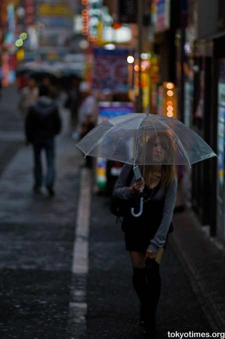 Japanese people in the rain