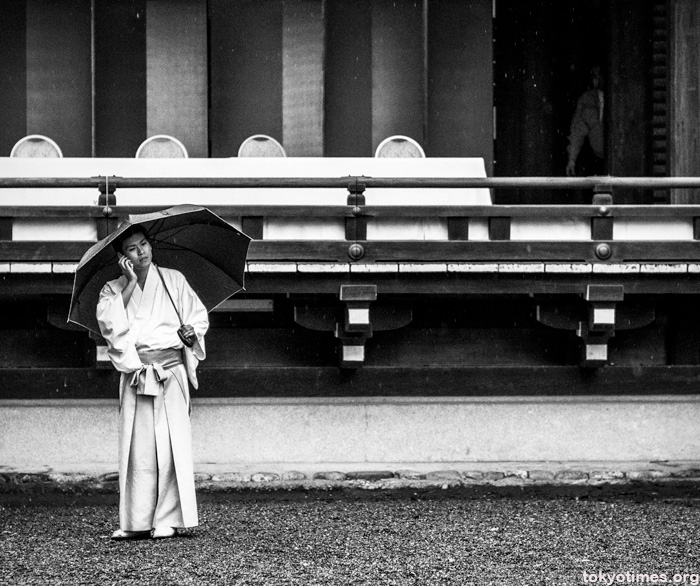 Japanese priest in the rain