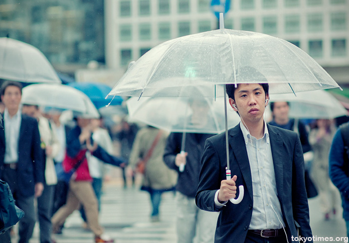 Japanese salaryman in Shibuya during rain season