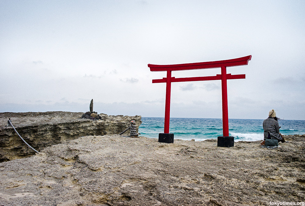 Japanese torii by the sea in Shimoda