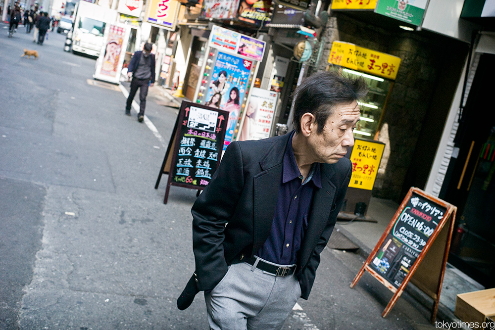 Japanese man prowling the streets of Shinjuku