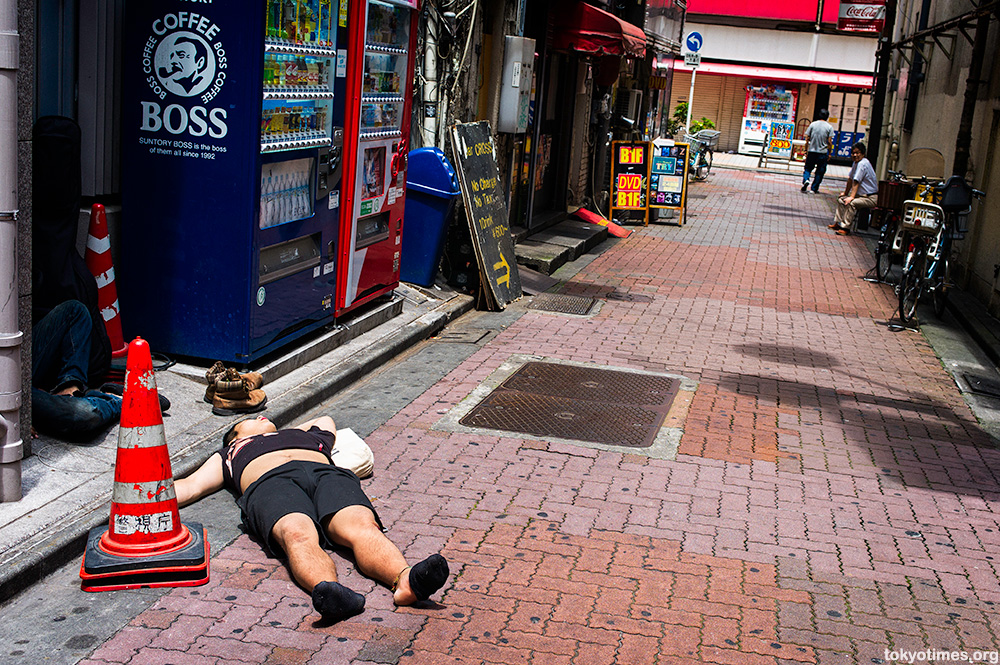 drunk and sleeping in Tokyo