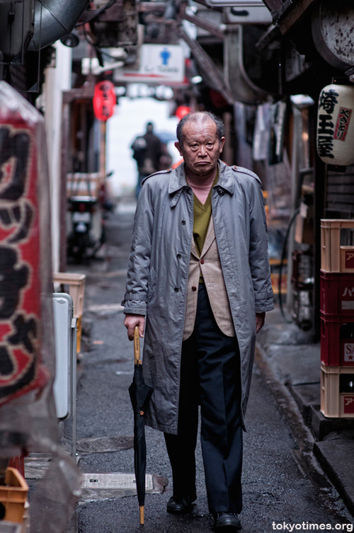 An old Japanese man in Shinjuku Memory Lane