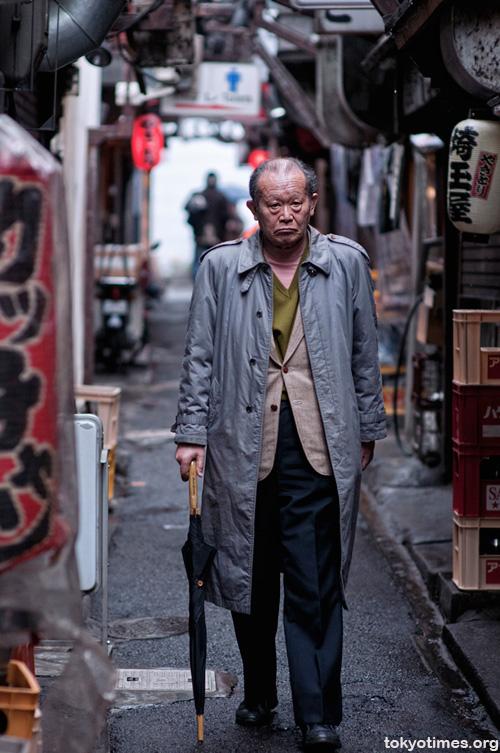 An old Japanese man in Shinjuku Memory Lane