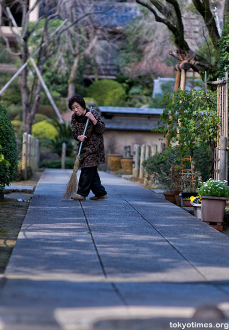 Japanese woman sweeping