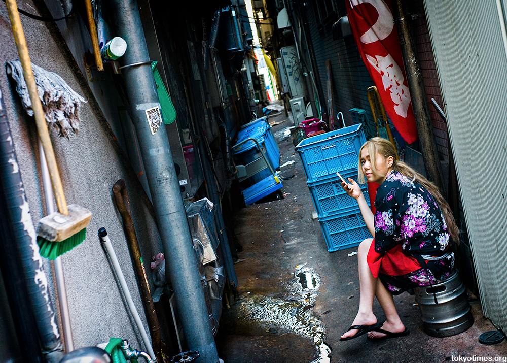Japanese woman in a dirty Tokyo alley