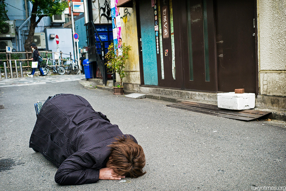 drunk and asleep in Tokyo