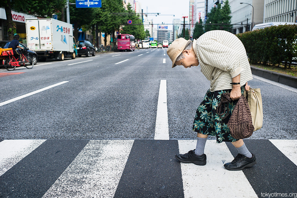 Tokyo old lady bent double