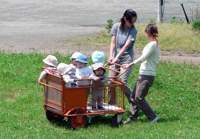 kids in a cart