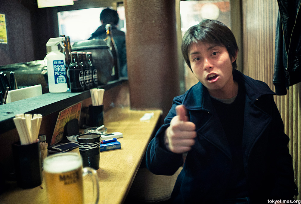 young Japanese drinker in Tokyo