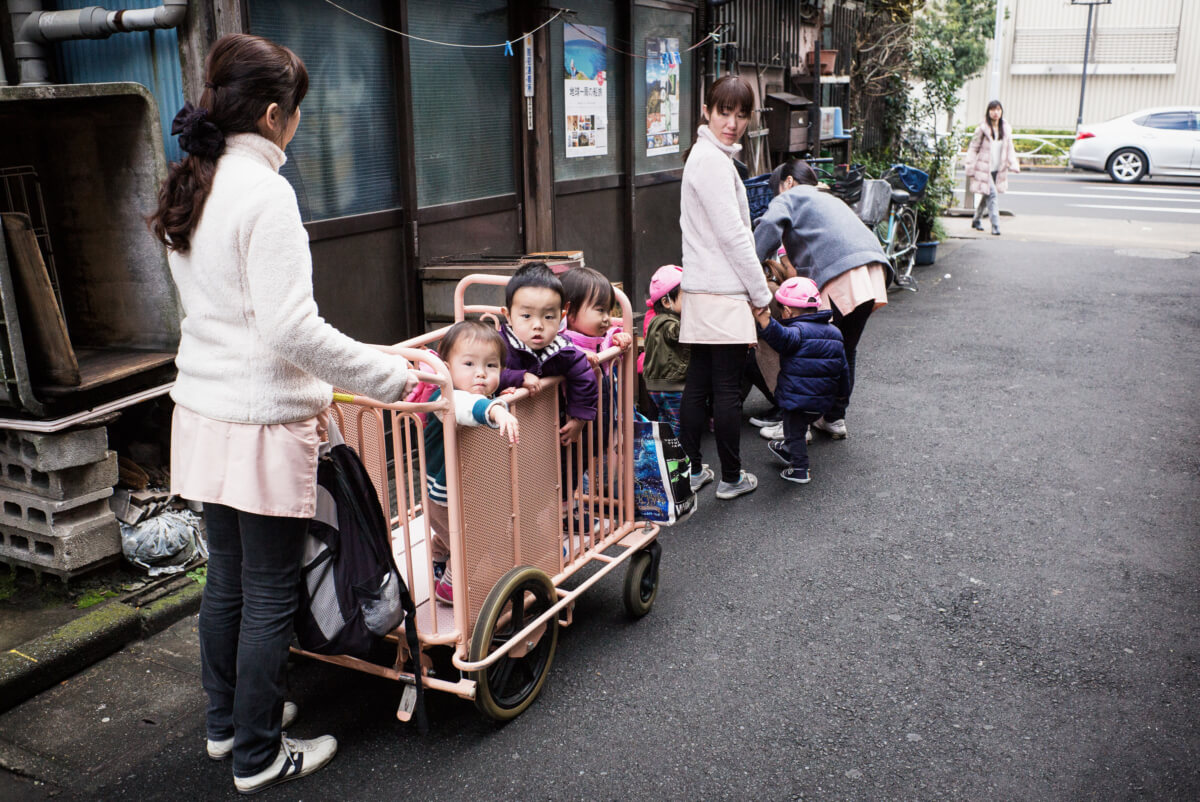 Japanese kids being pushed about in a cage