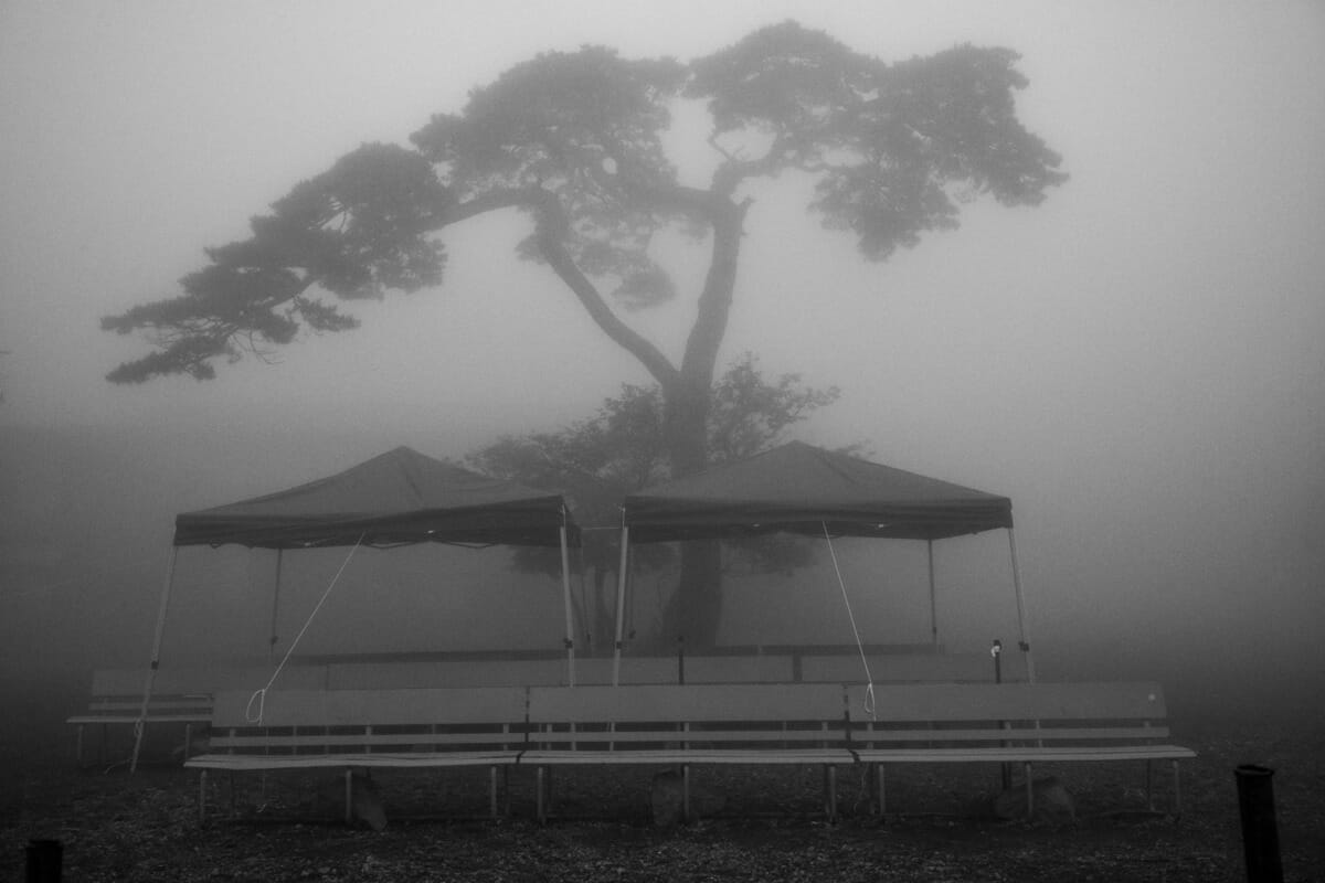 an old and faded Japanese tourist spot in the fog