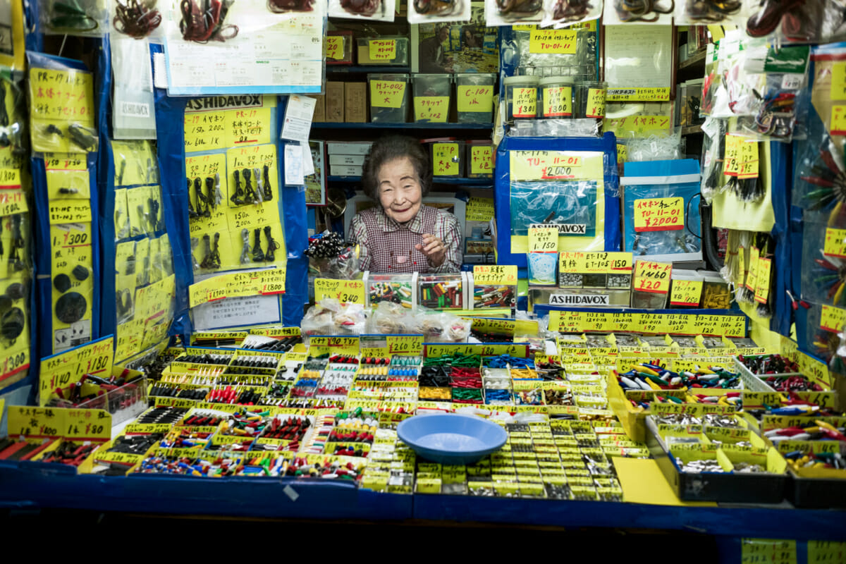 a smiling old Japanese lady in her very little tokyo shop