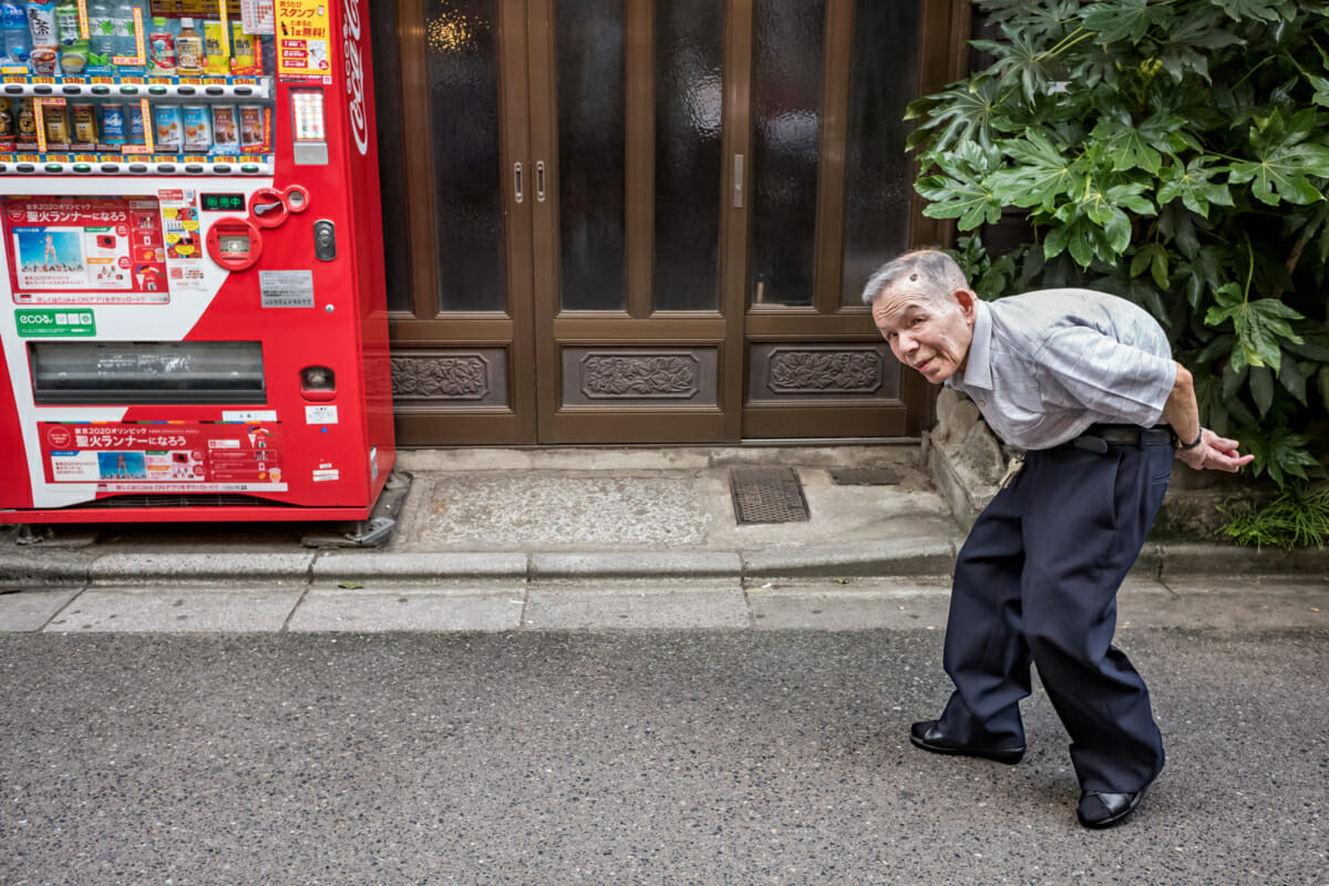 a bent double old Japanese man