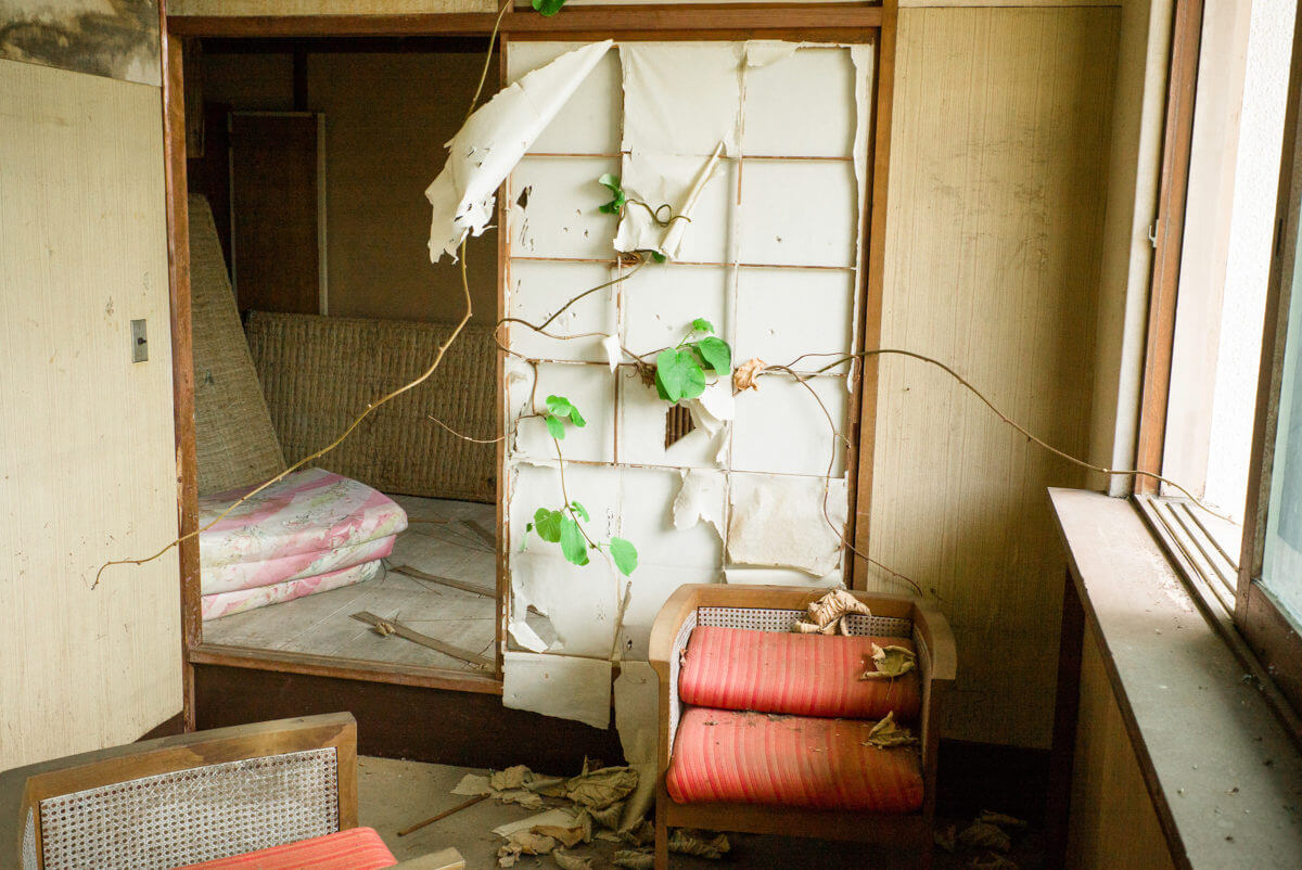 abandoned and overgrown japanese hotel