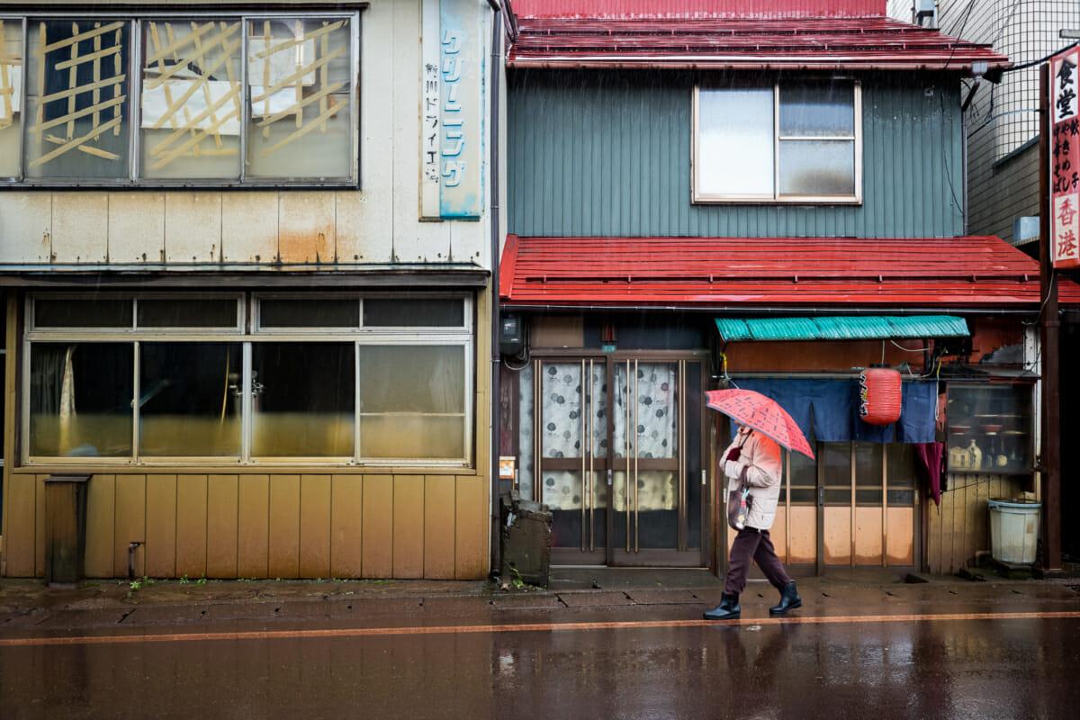 An elderly Japanese lady in her old ramen shop