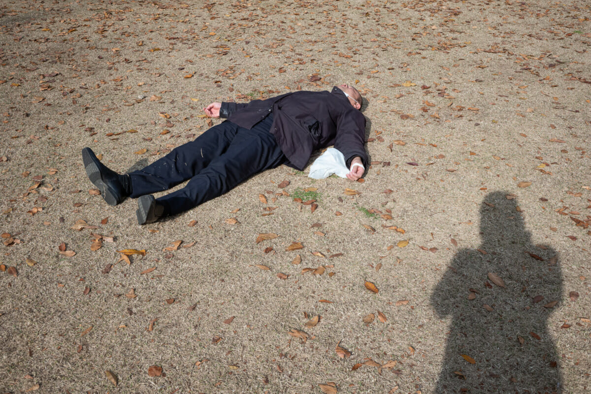 sprawled out and asleep tokyo salaryman
