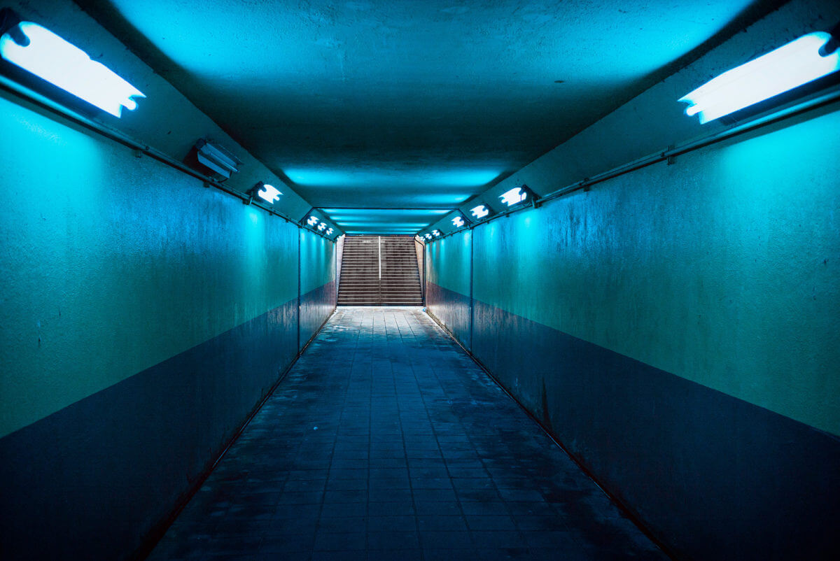 blue lit Japanese underpass