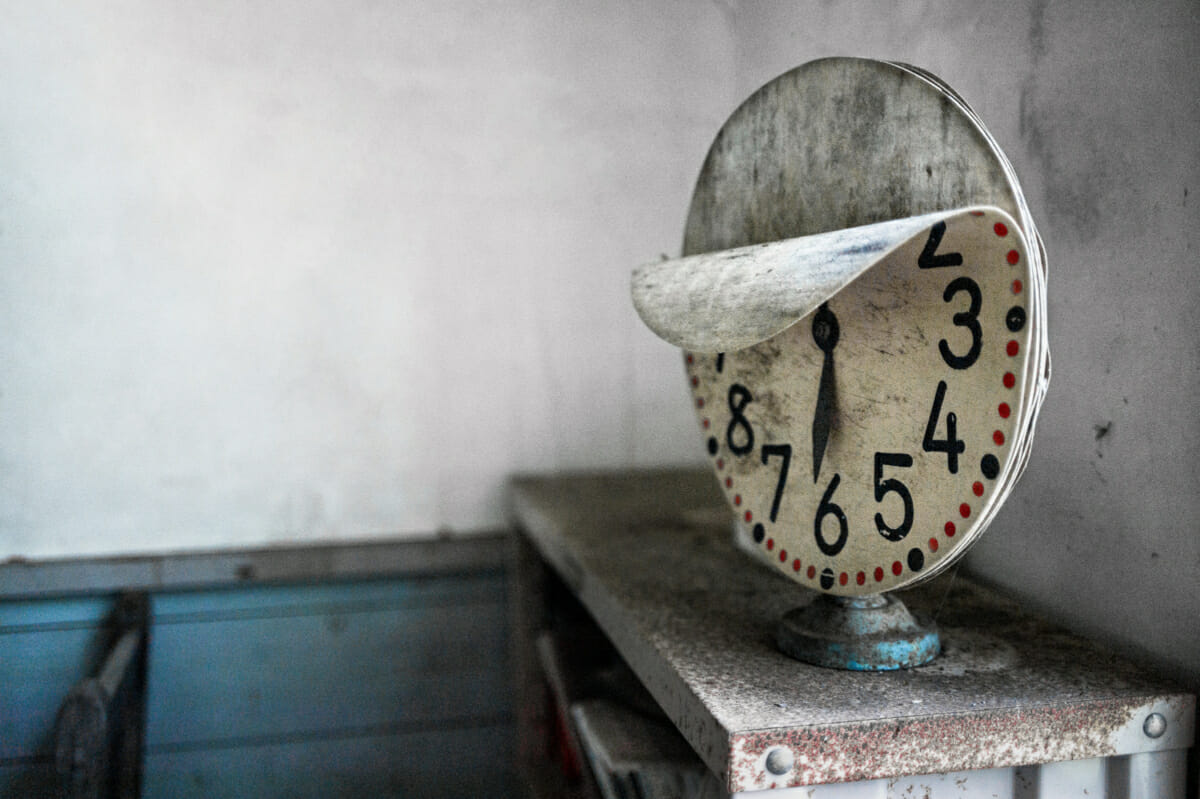 clock in an abandoned school