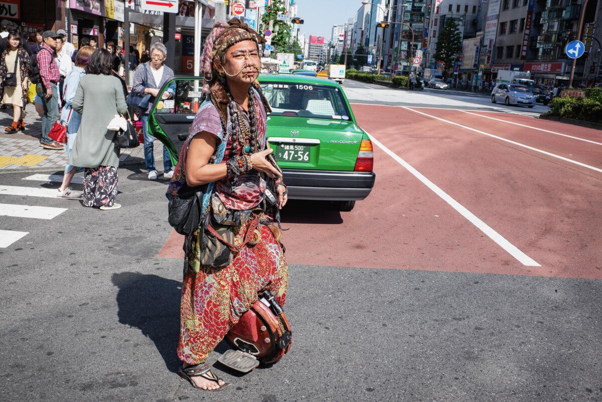 A colourful Japanese motorised unicycle rider
