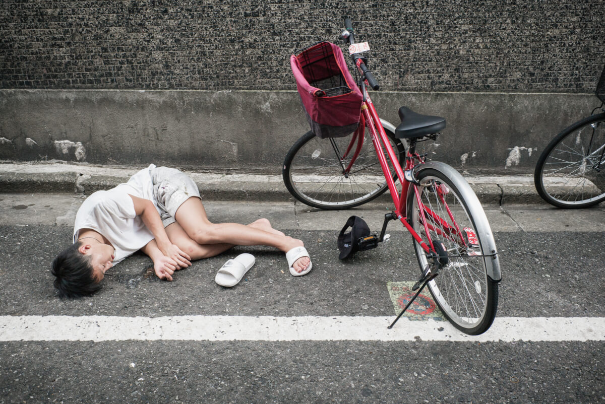 Drunk and asleep on a Tokyo side street