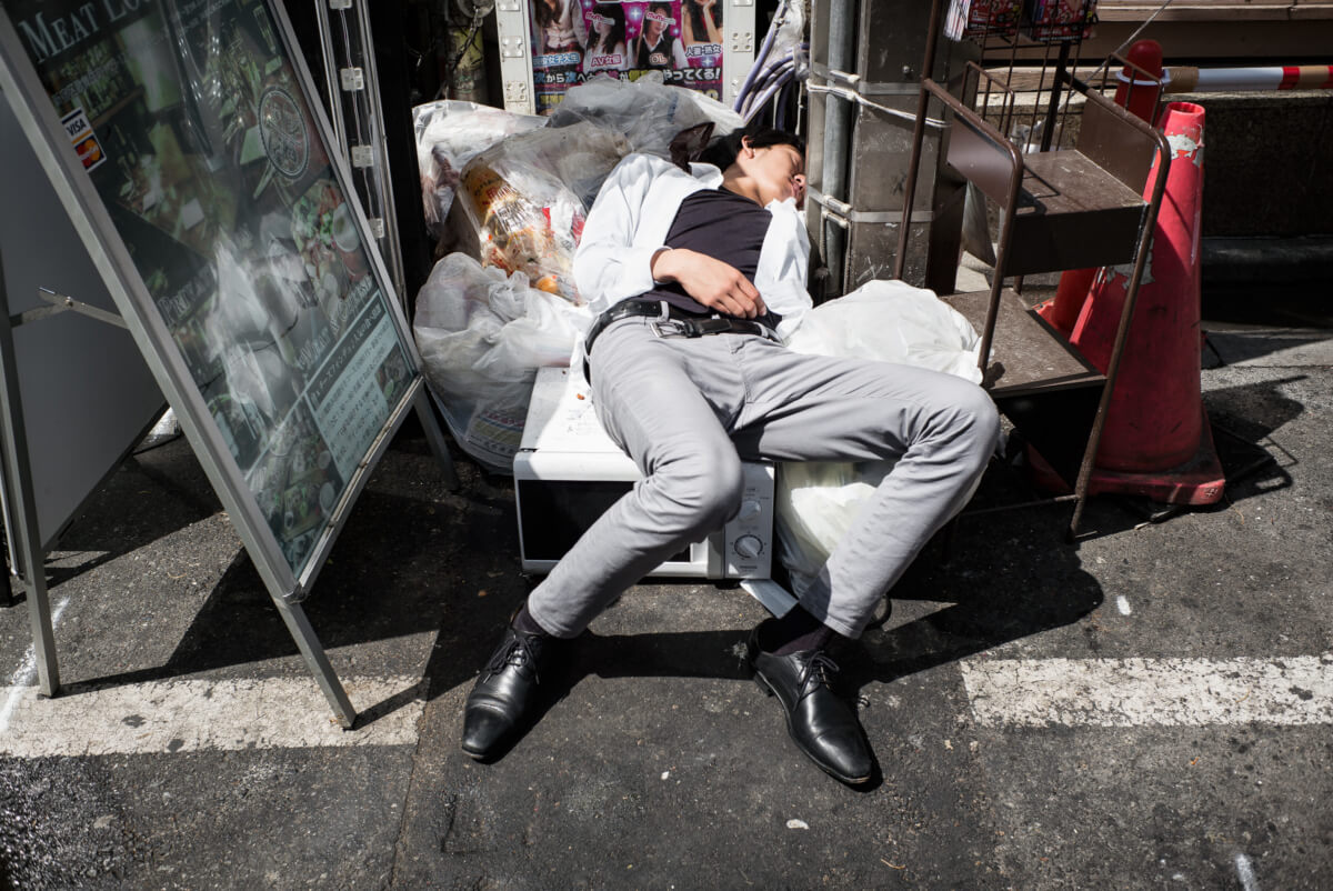 drunk and asleep on a Tokyo street