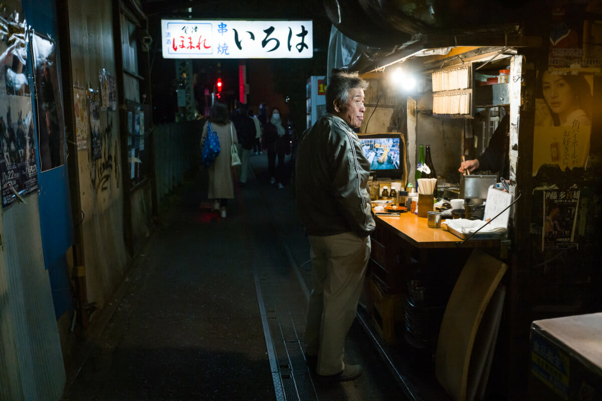 a dystopian Japanese drinking alleyway