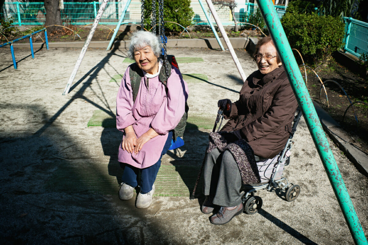 elderly Japanese women in a children's playground in Tokyo