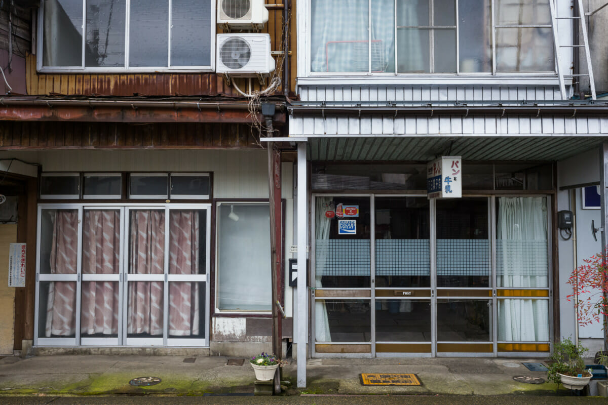 The faded traditional shop fronts of an old Japanese town