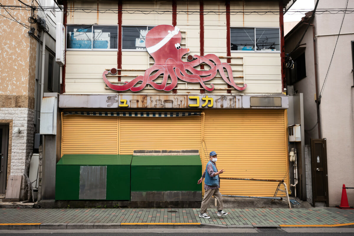 giant Tokyo octopus and a gestured insult