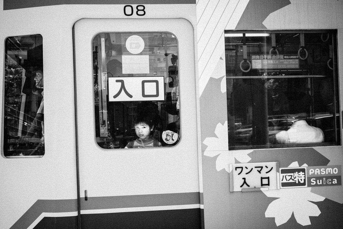 japanese boy at the Tokyo tram window