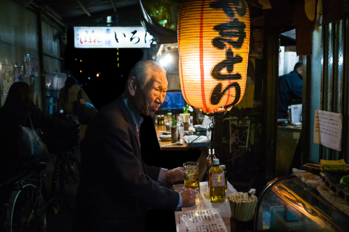 Japanese alleyway drinks, a lantern and an illuminated face