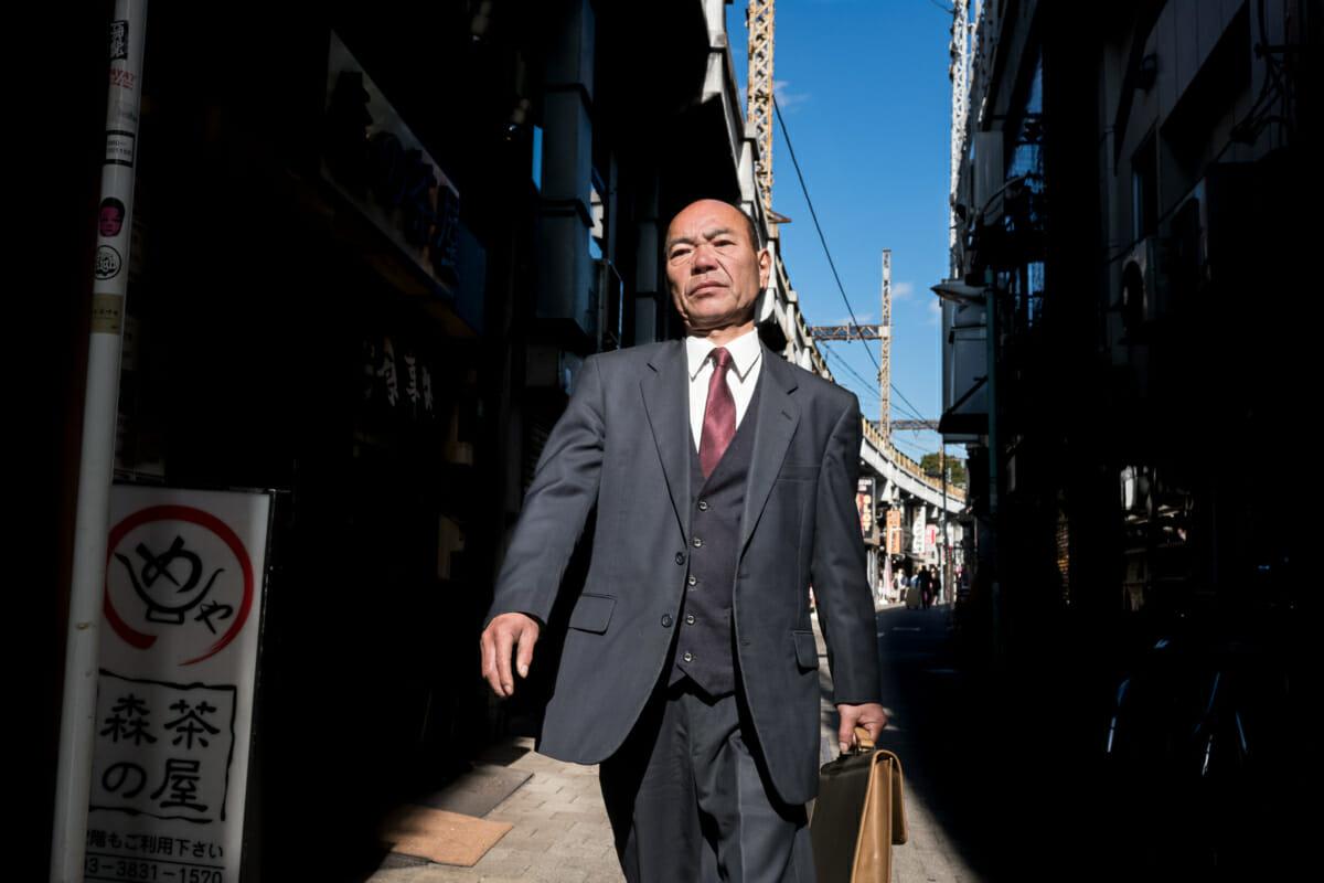 a swaggering Japanese salaryman in Tokyo
