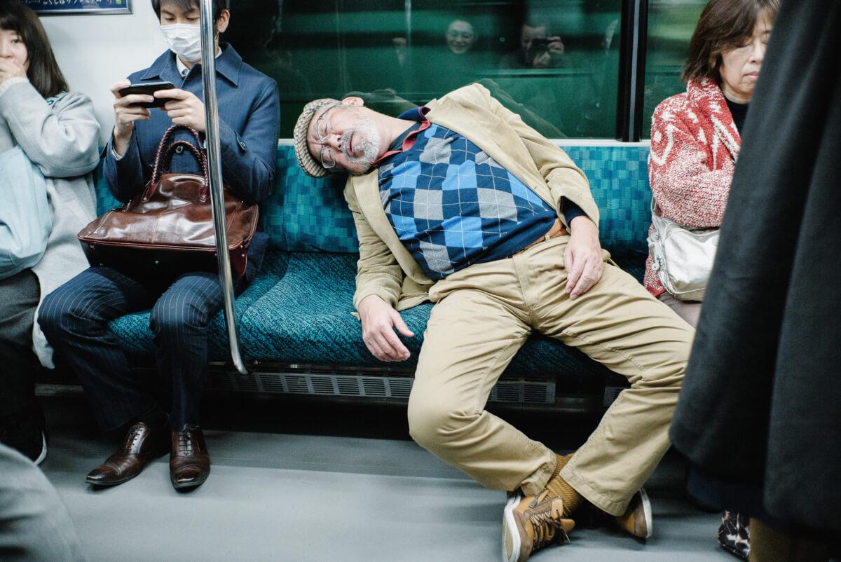 drunk man on a Tokyo train