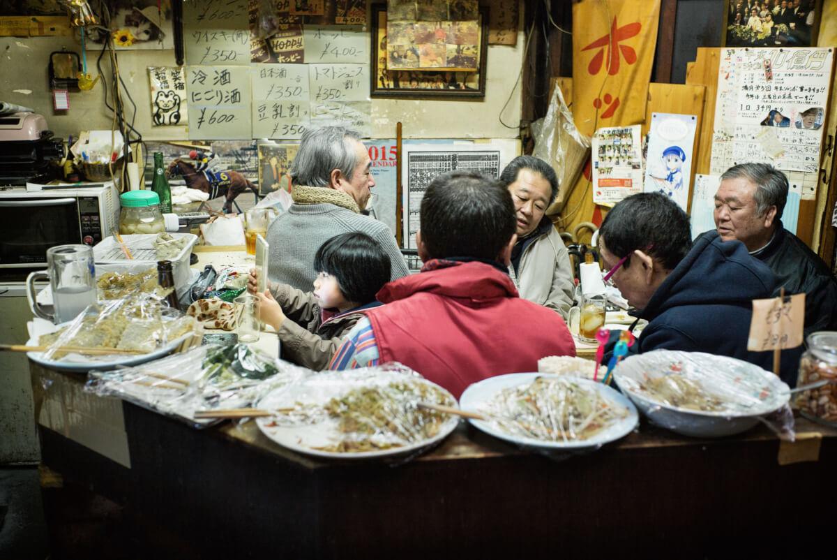 A little Japanese girl in a grubby little Tokyo bar